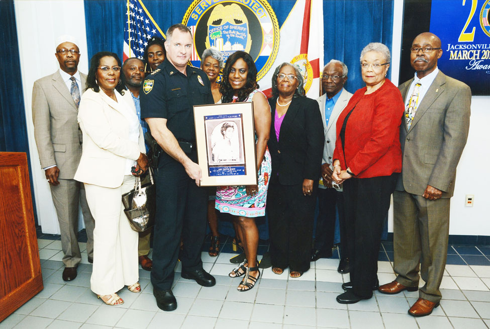 Pictured is daughter Juanita Allen holding the award surrounded by family members Daughter Beverley Watson, Grandson Mario Jennings, Jamie Jamison, Granddaughter Arnessa Wilson, Daughter Sheryl Wilson, Mr. and Mrs. Claude Thompson, Mr. & Mrs. James Jennings.