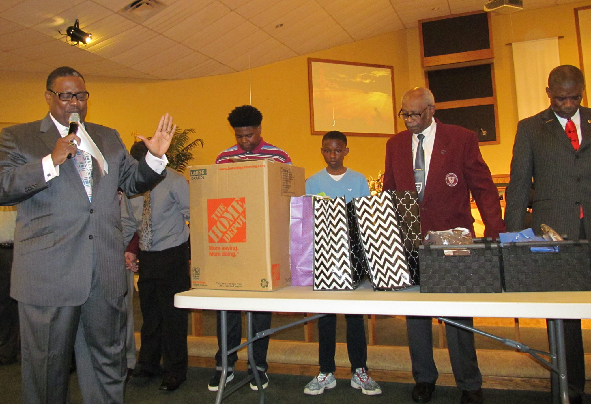 Shown praying for the program is Reverend Marvin C. Zander, II of St, Paul AME Missionary, students Alvin Marks, Jordan Wells, Sons of Allen Chairperson Joseph Coppock, Jr. and Tony Hill.