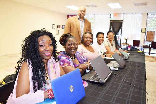 Pictured standing is E3 Business Group leader Anthony Butler with entrepreneurs Michelle Poitier, Arlene Cameron-Lloyd, Rasheda Mitchell, Ceandra Dilley and Deborah Raickett.