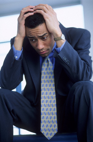 01 Sep 2000 --- Worried businessman --- Image by ©LWA-Stephen Welstead/CORBIS