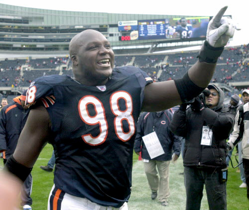 "October 26, 2003--Bears-Lions--A happy Bears defensive tackle Bryan Robinson says ""We'll take it"" as he comes off the field after the Bears defeated the Lions 24-16-- Sun-Times photo by Tom Cruze"