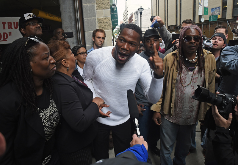 Activist and pastor Westley West, center, expresses his anger after a Baltimore City police officer was found not guilty of all charges relating to the death of Freddie Gray last year. Another officer involved in the case, Caesar Goodson, who drove the police van in which Freddie Gray was injured, was found not guilty on Thursday. KENNETH K. LAM/TNS via ZUMA Wire