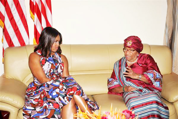 U.S. First lady Michelle Obama, left, listens to Liberian President Ellen Johnson Sirleaf, right, after she arrived at the airport in Monrovia, Liberia, Monday, June. 27, 2016. Obama is visiting a leadership camp for girls in Liberia to launch her latest Africa visit in a country still recovering from the recent Ebola epidemic that left thousands dead.