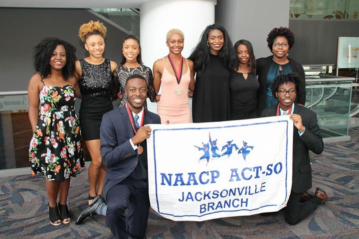 Bertha Jones, Kaila Justice, Aahkilah Cornelius (Silver Medal - Dance Contemporary Competition), Alexis Monroe, Celina Johnson, Adaeze Ikeokwu; kneeling Nicolas Mote (Bronze Medal/Drawing Category) and Karryl Eugene (Silver Medal/Painting Category).