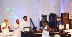 Shown are Mark Marshall, JJS President and JJS Interim Vice President J. Valentine presenting scholarship to recipient Jacinto Sims, II and Tariq Adkins. Standing in the background is Jacksonville Jazz Society President Na'im Rashid.