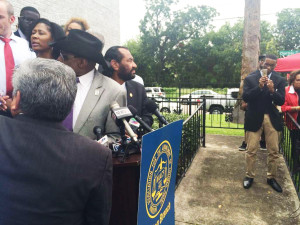 NAACP leaders square off against the protesters behind the line.