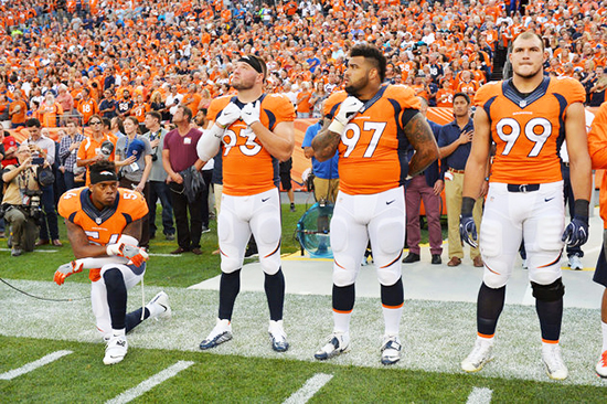 Sep 8, 2016; Denver, CO, USA; Denver Broncos inside linebacker Brandon Marshall (54) kneels during the national anthem next to defensive end Jared Crick (93) and defensive tackle Billy Winn (97) and defensive tackle Adam Gotsis (99) before the game against the Carolina Panthers at Sports Authority Field at Mile High. Mandatory Credit: Ron Chenoy-USA TODAY Sports     TPX IMAGES OF THE DAY