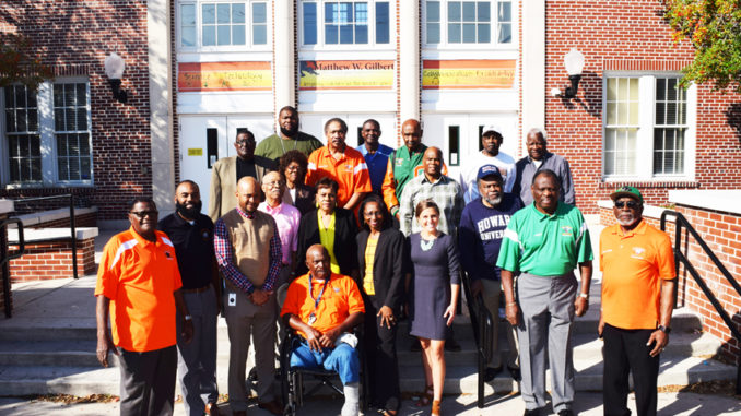 "Pictured L-R are committee members Charles Sutton (seated) surrounded by Bobby Newsome, Bobby Bailey, Katherine Beatty (MWG Assistant Principal), James Cotton, Anthony ""Tony"" Hill, Harriett Jarrett, Jessie Johnson, Harold Graves, Dr. Tyrus Lyles (MWG Principal), Kenneth Manual, Curtis Miranda, DCPS District 4 Paula Wright, Ervin Norman, Charles Sapp, Daniel Scott, Jackie Surrency and Leon Smith. SMV photo"