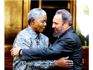 Nelson Mandela shared a hug with Fidel Castro