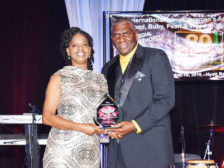 Shown above is Community Service honoree Carlbenie Hilliard accepting her award from ILA 1408 President Vincent Cameron.
