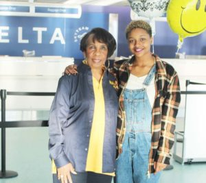 NAACP ACT-SO Advisor Sandra Thompson  proudly sees Aahkilah off at the airport.
