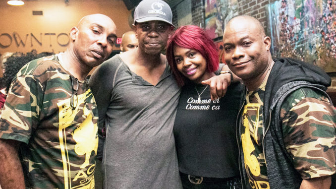 Shown enjoying Jax hospitality is fan Vault Johnson with  Dave Chappelle and Cigar Bar owners Simone and Troy McNair.