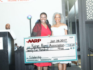 Pictured is Gala sponsor, AARP Jacksonville Field Coordinator,Justine Conley,presenting a check for $2,500 to Dr. Justine Redding for Raines student scholarships. Ronnie Lott Photo