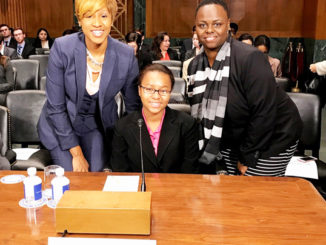 Shown seated is Jinique Blyden surrounded by PACE Chief External Affairs Director, Nona Jones (r) and PACE Reach Coordinator, Tabitha Bush (l).