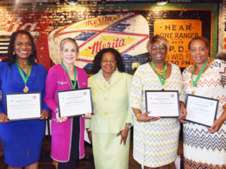 Shown is Troop Administrator Sharon Coon pictured with honorees LaShonda Holloway, Emily Lisska and Melody Yarborough and Cheryl Davis