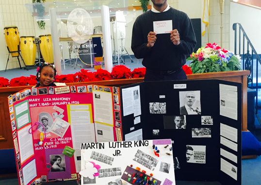 Shown is first place winners Kindergartner Imani Diatti and high school senior Rasheed Lewis with their projects.
