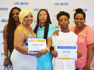 Pictured l-r is Mashawanda Mack, Mary Mainor, Jean Ribault Mother of the Year awardee Darniese Arnold