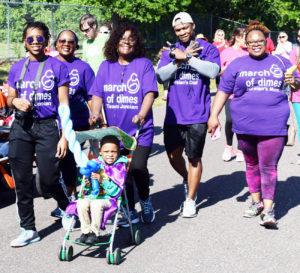 Shown (L-R) MOD walkers Asia Barlow, Antonia Barlow, Cynthia Barlow, Jarell Dennis, Angela Dennis and Joreian Dennis (born six weeks premature  weighing only 3lbs., now age five) in the stroller.