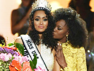Miss USA Kara McCullough gets a well wish hug from Miss USA 2016