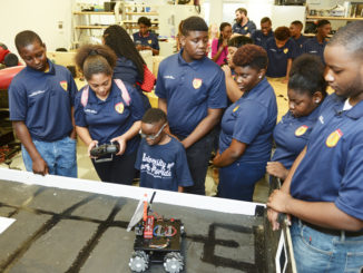 Teens with the JaxPAL Teen Leadership Program get introduced to STEM careers and robotics during a tour of the University of North Florida campus, launching the new OspreyPAL program. Photos by Katerina Turner