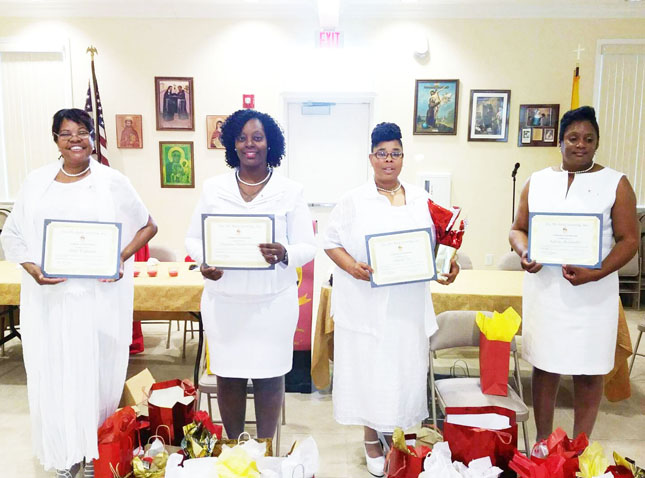 The new members inducted on May 27th are (L-R) Debi Williams, Angelus Martin-Green, Angela Lee and Sylvia Alexander