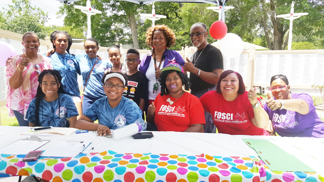 Shown supporting Unity in the Community l - r are Barbara English, Rita English, Alyanna Barlow, Jasmine Bowmna, Jason Bowman, Beverly McClain and A. Wellington Barlow. Seated Gabrielle Wright, Kristen Jordan, Octavia Brown, Jewel Flornoy and Charlotte Bell.