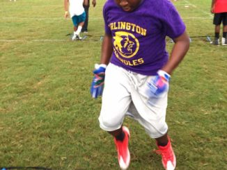 Show is Southside Middle school 8th grader TyVier Brown participating in Ladder Drills