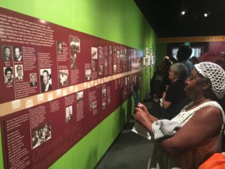 Maggie Tobler, Ricky Anderson and Sharon Hudson carefully went down the timeline of the exhibit of the city's race relations.