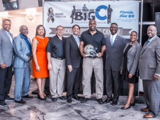 Pictured l-r Councilman Sam Newby; Mia Jones, Executive Director Agape Community Health Center; Peter Racine of the Jaguars Foundation; Dr. Ali Kasreaian Urology; Kevin Hardy, former Jacksonville Jaguar; Charles Griggs, President, 100 Black Men of Jacksonville, Inc.; State Senator Audrey Gibson; and Darnell Smith, Market President North Florida Region Florida Blue.
