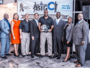 Pictured (L-R):  Councilman Sam Newby; Mia Jones, Executive Director Agape Community Health Center; Peter Racine of the Jaguars Foundation and Community Impact; Dr. Ali Kasreaian, Kasreaian Urology; Kevin Hardy, former Jacksonville Jaguar; Charles Griggs, President, 100 Black Men of Jacksonville, Inc.; State Senator Audrey Gibson; and Darnell Smith Market President North Florida Region Florida Blue.