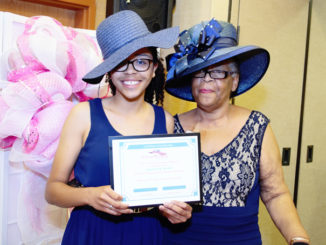 Pictured is one of three scholarship awardees Anastasia Daniels and Director of Education Chair Diva Deborah Richardson