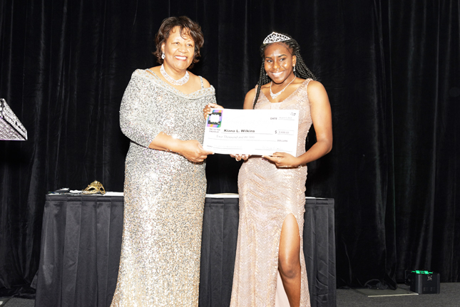 Shown is scholarship recipient Kiana L. Wilkins of WOCCF's Universal Teen Program accepting a $2,000 scholarship check presented to her by WOCCF president Helen Jackson.