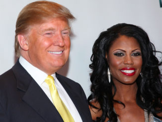 President Donald Trump (L) and Omarosa Manigault