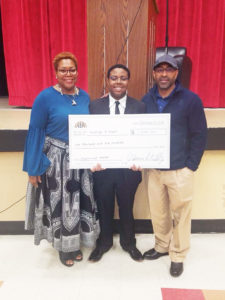 Shown above are proud parents Marsha Pratt with first place oratorical contest winner George Jr. and dad George Pratt, Sr.