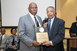 "Shown is ""Athlete Award"" winner and former FAMU football player Jerome Elps, II, with emcee Ed Hall."