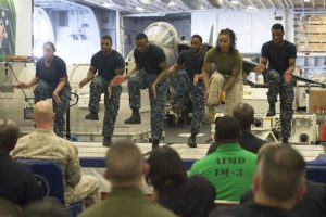 Sailors and a Marine perform a step dance during the African American and Black History Month celebration aboard the amphibious assault ship USS Makin Island (LHD 8).  The ship is deployed in the U.S. 5th Fleet area of operations in support of maritime security operations designed to reassure allies and partners, and preserve the freedom of navigation and the free flow of commerce in the region. (U.S. Navy photo by Mass Communication Specialist 3rd Class Devin M. Langer)