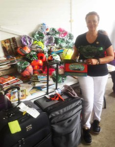 National President of The Links, Incorporated Dr. Glenda Newell-Harris with many of the school gifts.