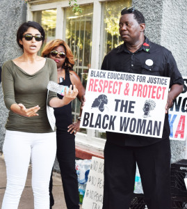 Shown protesting on 9th and Liberty Street, the site where unarmed Vernell Bing was shot and killed by a Jacksonville Sheriff's Officer are  Sara Mahmoud and James Evans speaking to movement supporters.