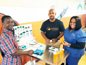 Shown at the grand opening are DAndre Jones, Dr. Albert Chester and instructor nurse Tia Hadley