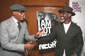 """Samuel L. Jackson (who narrates """"I Am Not Your Negro,"""") and actor Isaiah Washington greet each other during a recent screening of the film. (Photo courtesy of Magnolia Pictures)"""