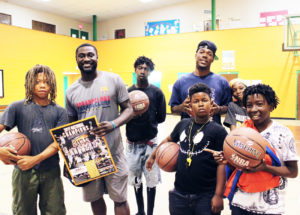 Shown is Jacksonville native Tyrell Johnson, overseas player for El Salvador LMB and Jacksonville Giant basketball player Keith McDougal shooting the hoops with Eureka Gardens student residents.