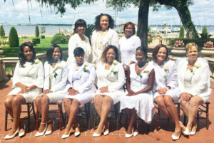 Shown at the occasion are (L-R) STANDING: Chapter Vice President Ruth Waters, Southern Area ViceDirector Sylvia Perry and Chapter President Pamela Prier.SEATED: New members Lisa Moore, Shamika Baker, Tia Leathers, Jannet Ford, Imani Hope, Tracee Holzendorf and Ivy Archer.