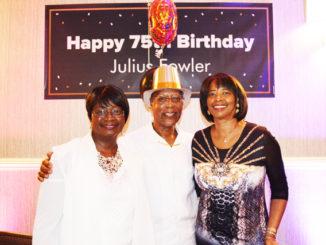 Shown is the honoree Julius Fowler enjoying his 75th birthday soiree.