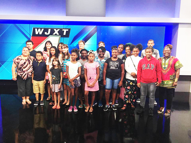 Shown touring the WJXT studios is Tristan's Pearls, staff and friends.