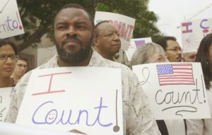 Felon Leroy Jones joins other demontsrators outside court in Miami, Wednesday, April 9, 2003, where the 11th U.S. Circuit Court of Appeals is hearing arguments on whether the state is doing enough to help ex-felons restore their voting rights. Jones finished his sentence 10 years ago.
